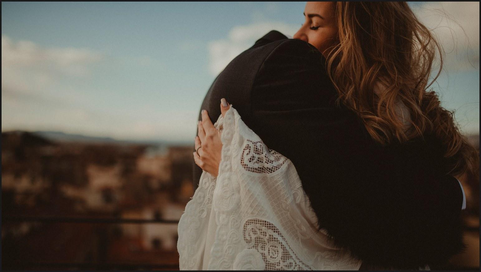 bride, groom, hug, elopement, rooftop, hotel torre guelfa