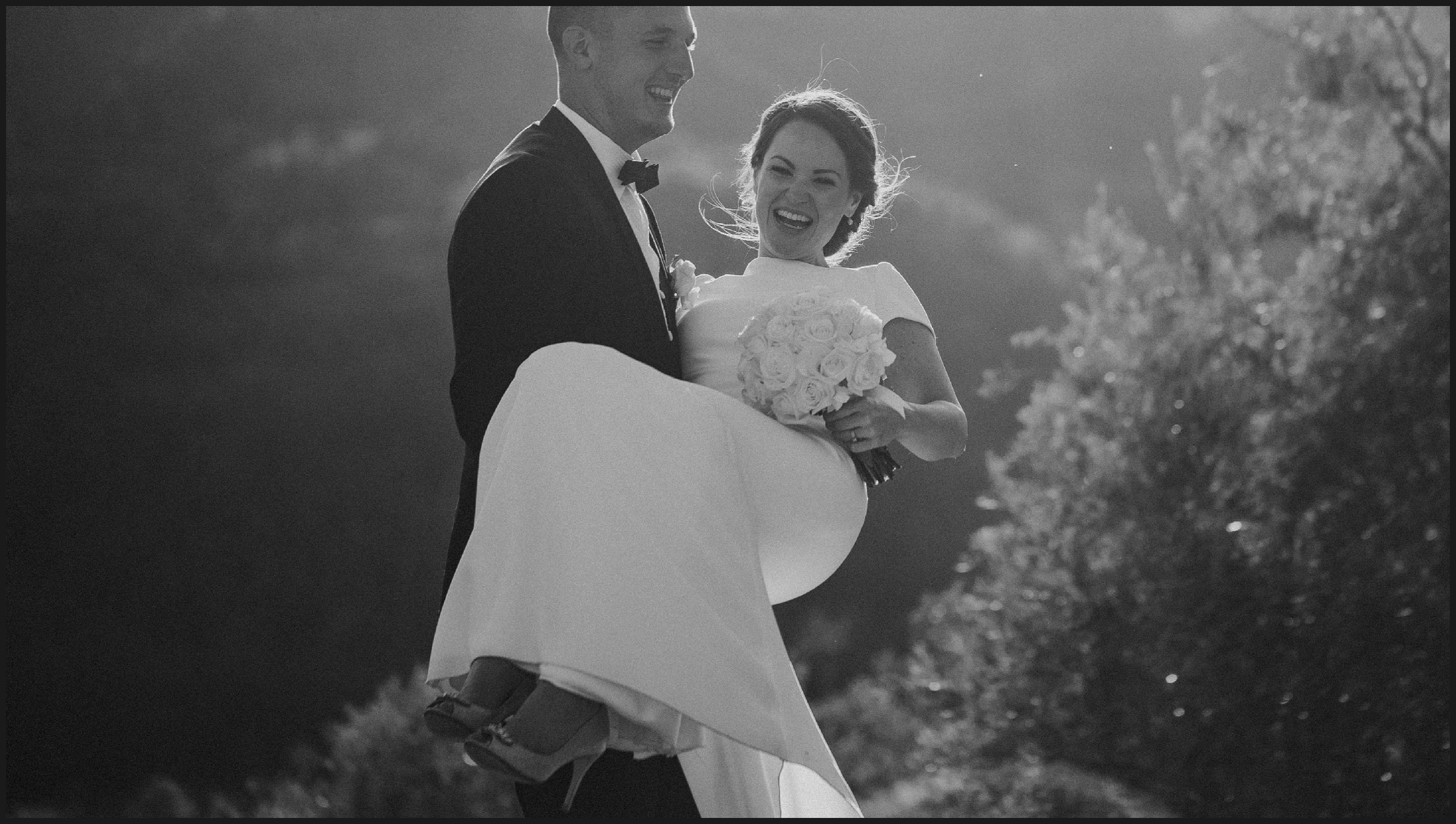 black and white picture of a funny moment between bride and groom