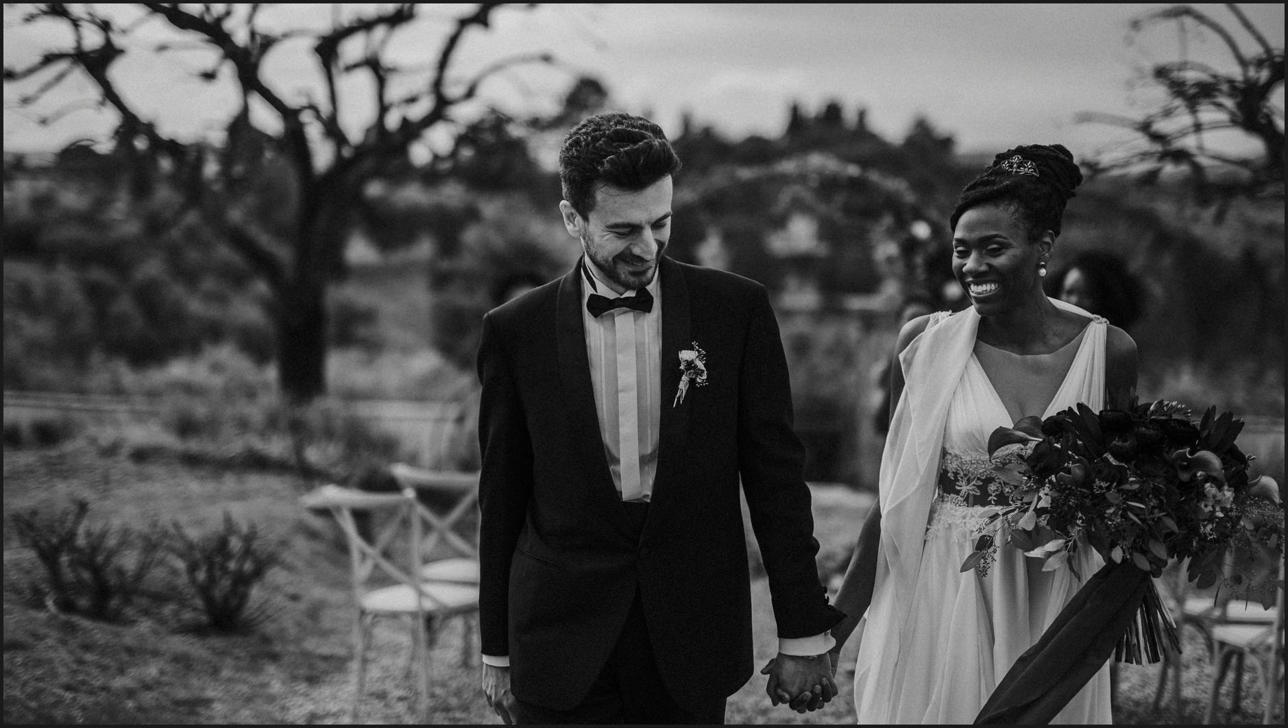 black and white, bride, groom, wedding, ceremony, villa medicea di lilliano, tuscany, holding hands