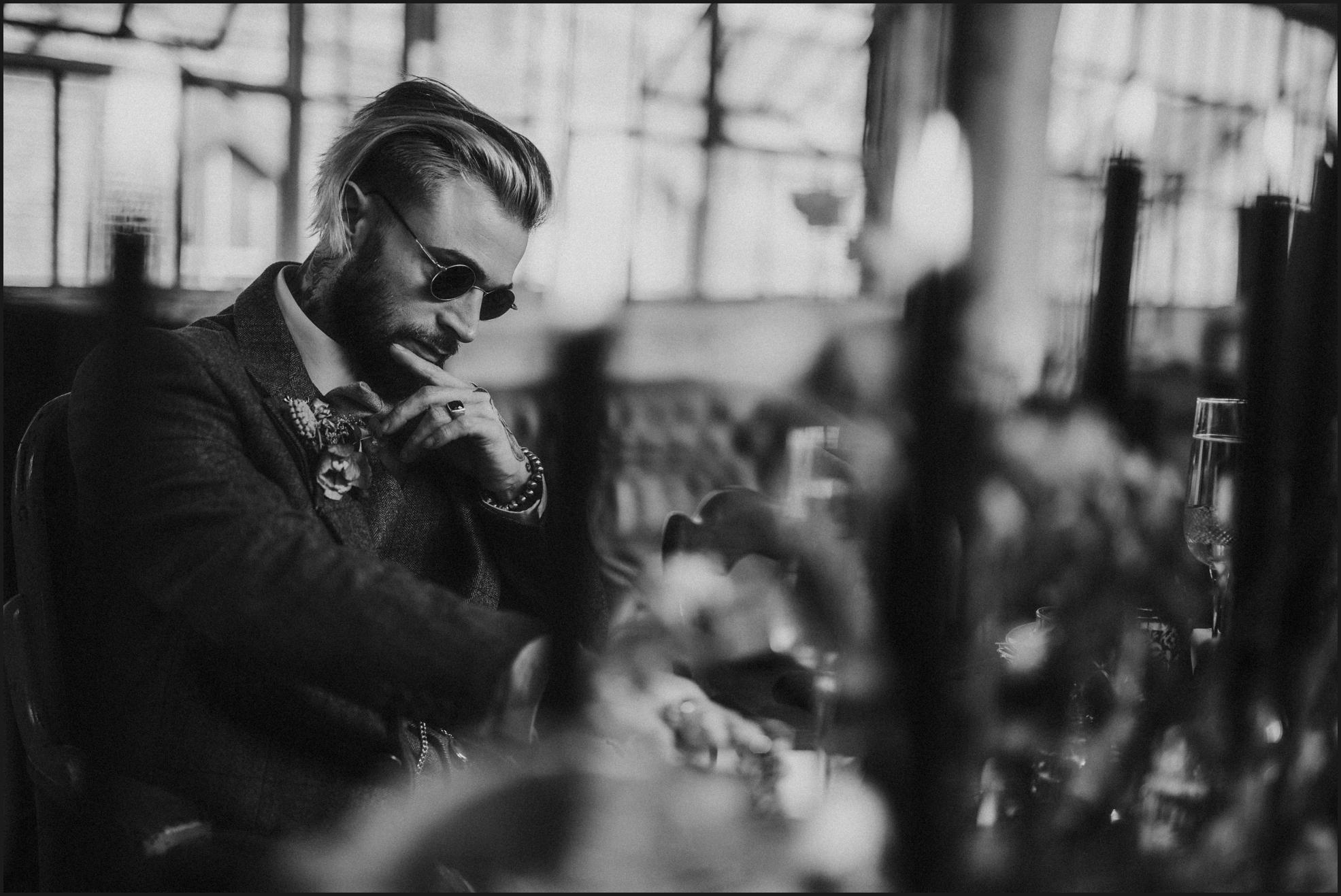 groom portrait, wedding table, sunglasses, rocking groom