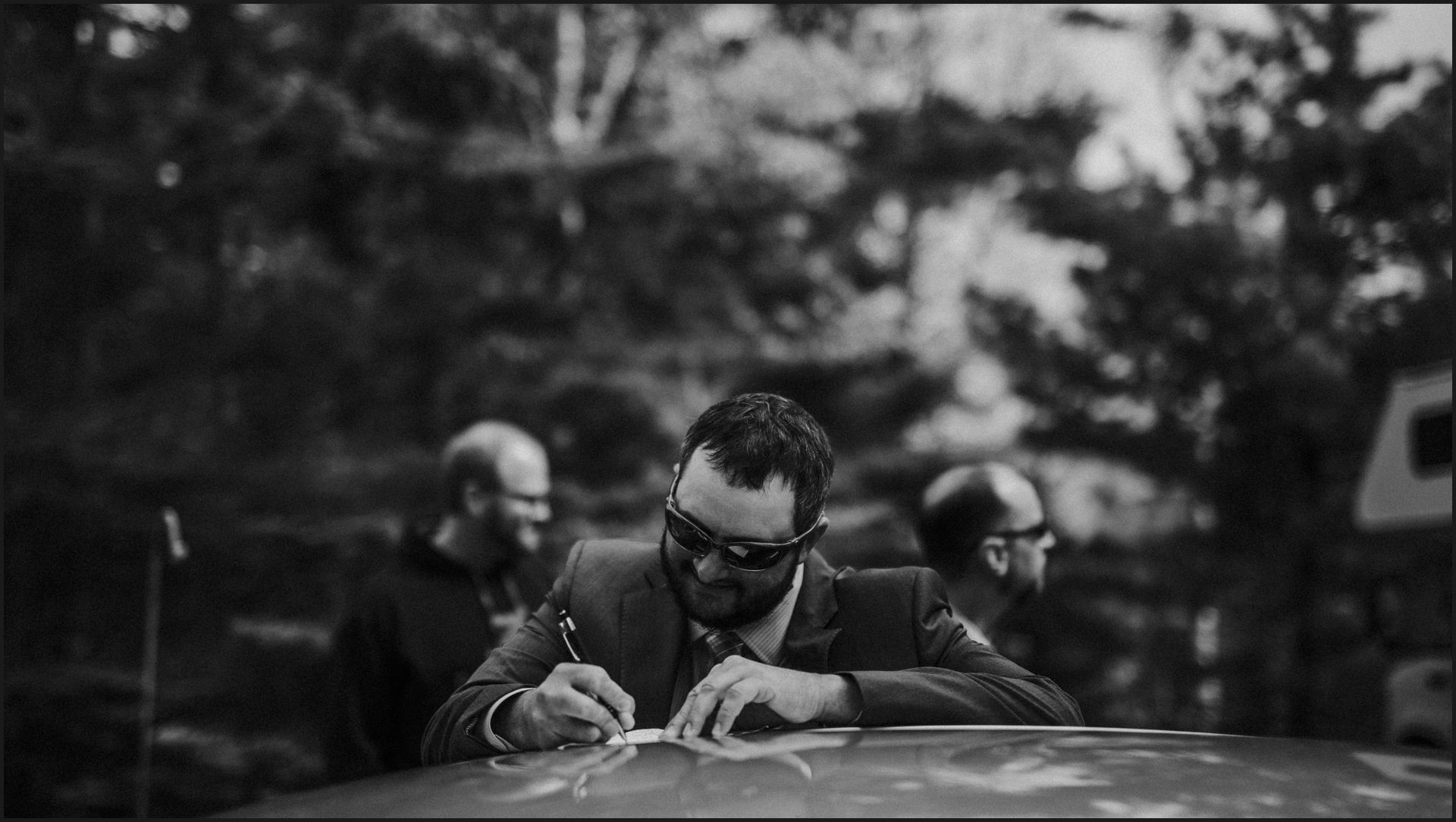 groom, black and white, groom writing, wedding vows