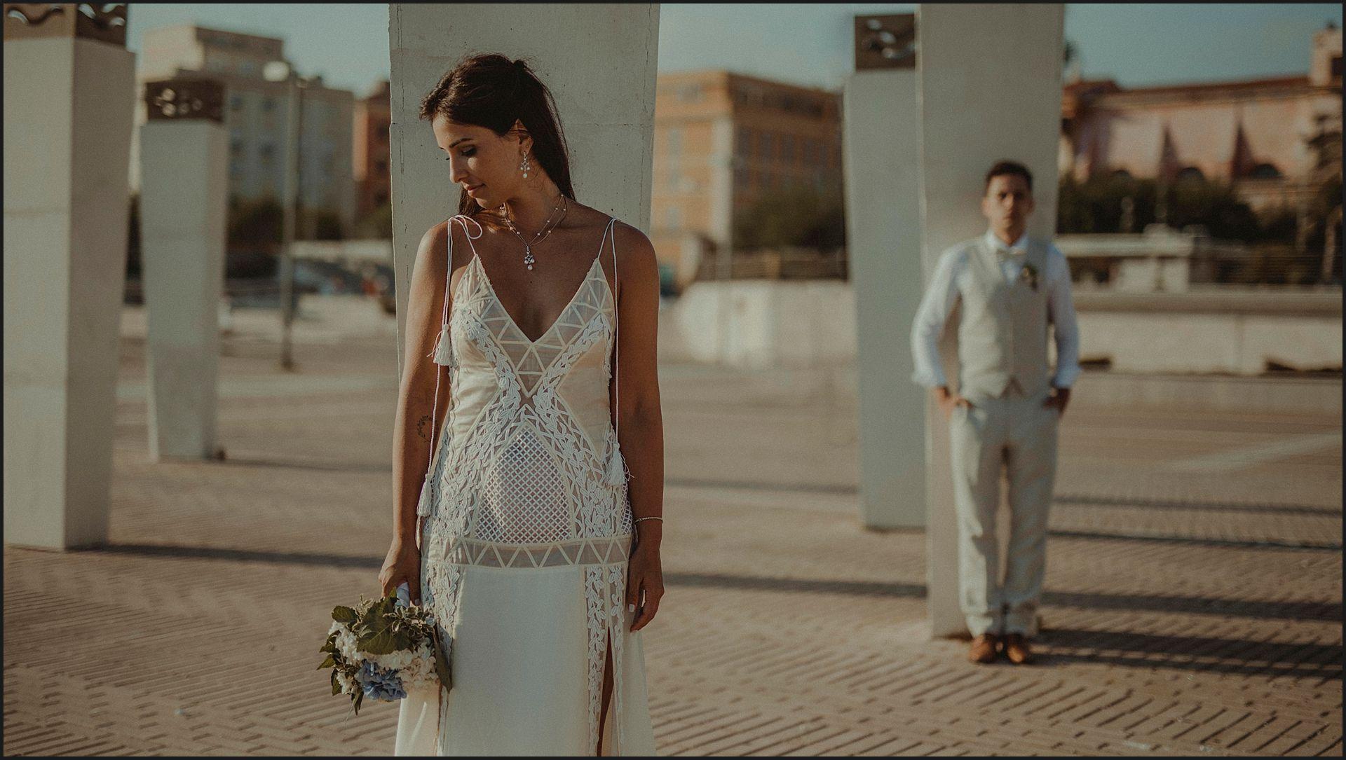 bride, groom, columns, destination wedding, white dress, wedding gown, civitavecchia