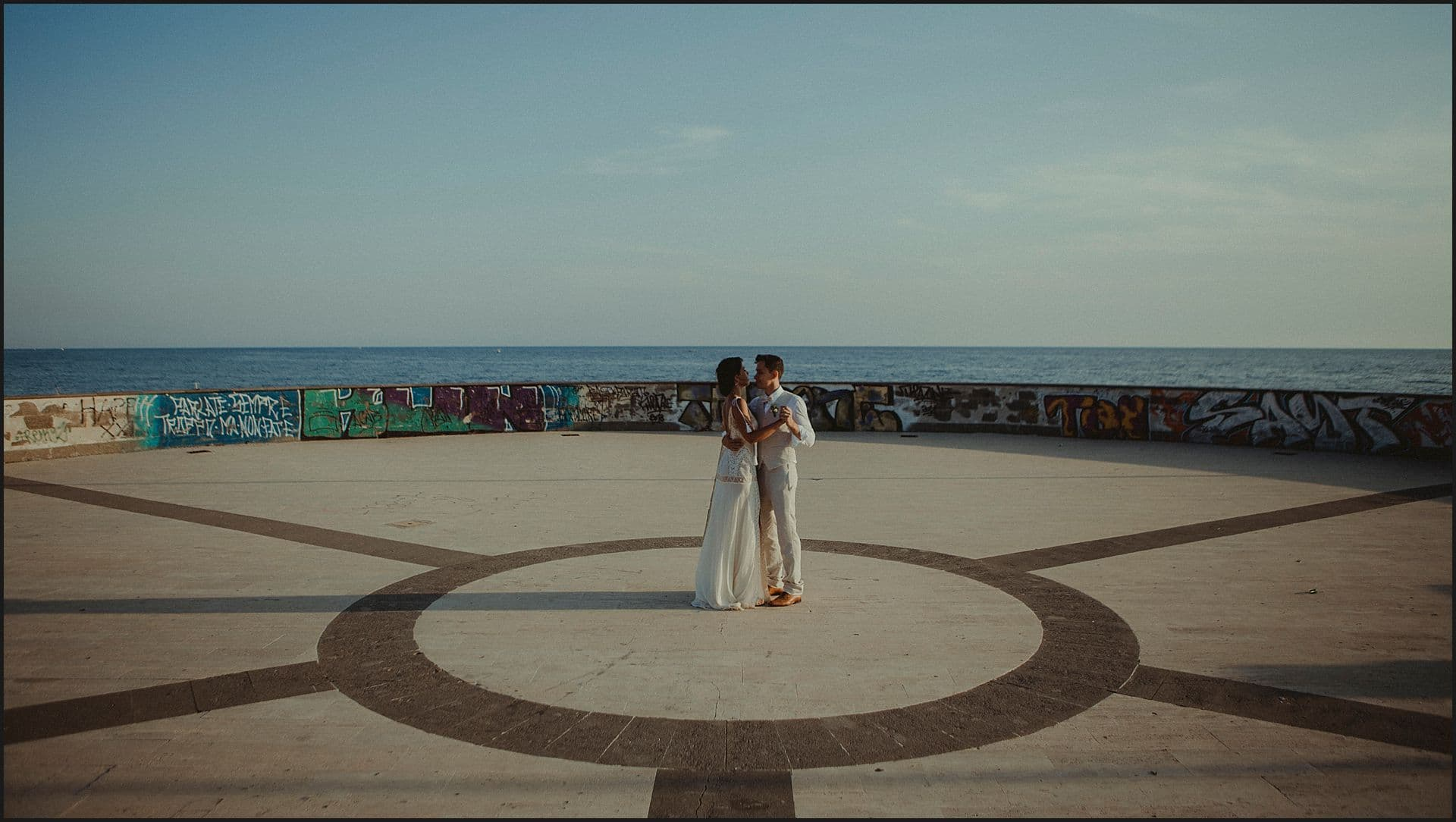 bride and groom, dancing, symmetry, geometries, landscape, sunset, sea, seaside, wedding by the sea