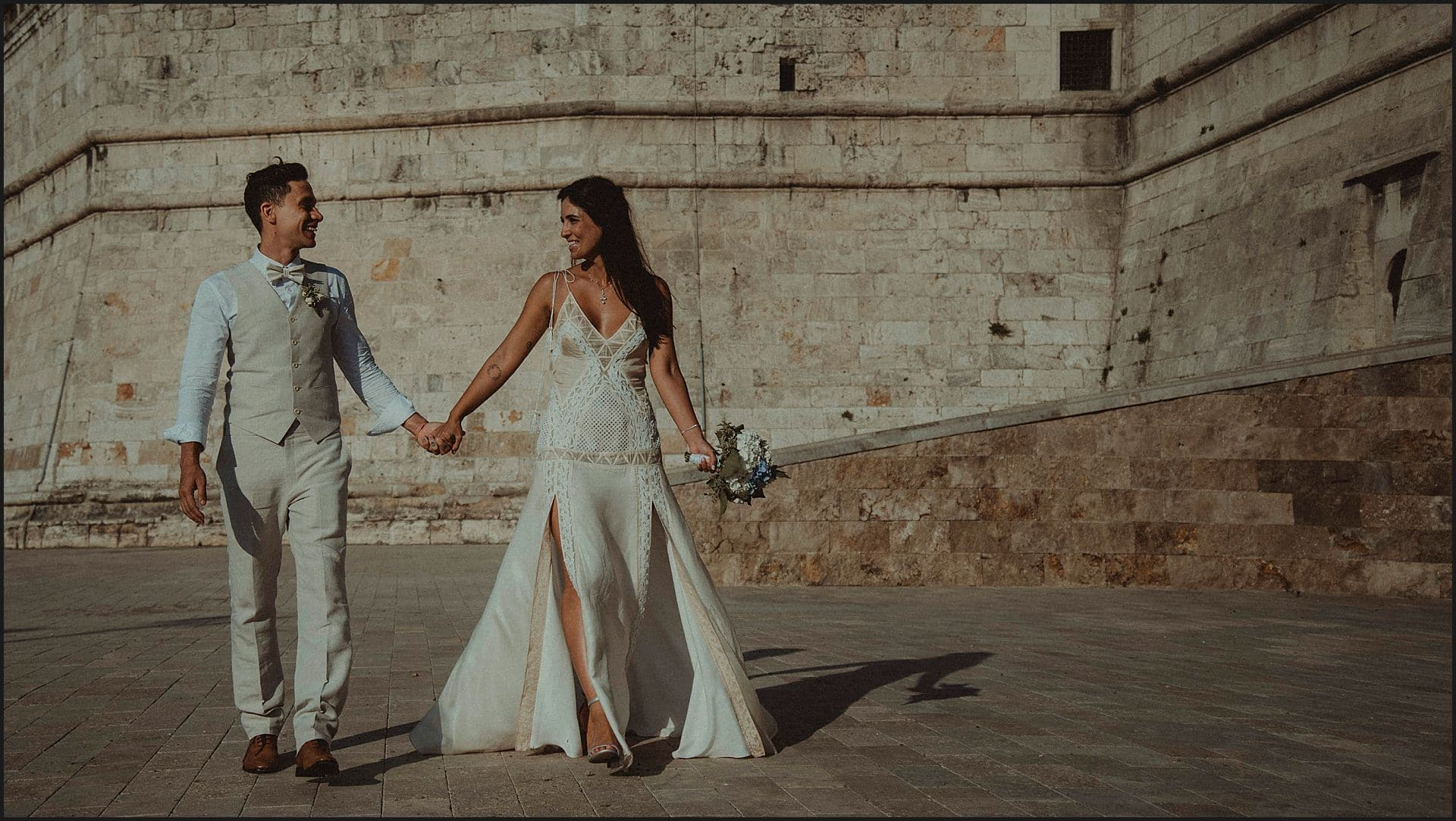 bride and groom, walking, hand in hand, destination wedding, wedding in white