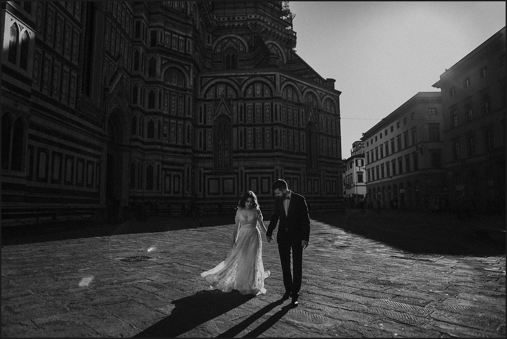 bride and groom, walking, piazza del duomo, destination wedding, elopement in italy, wedding in tuscany