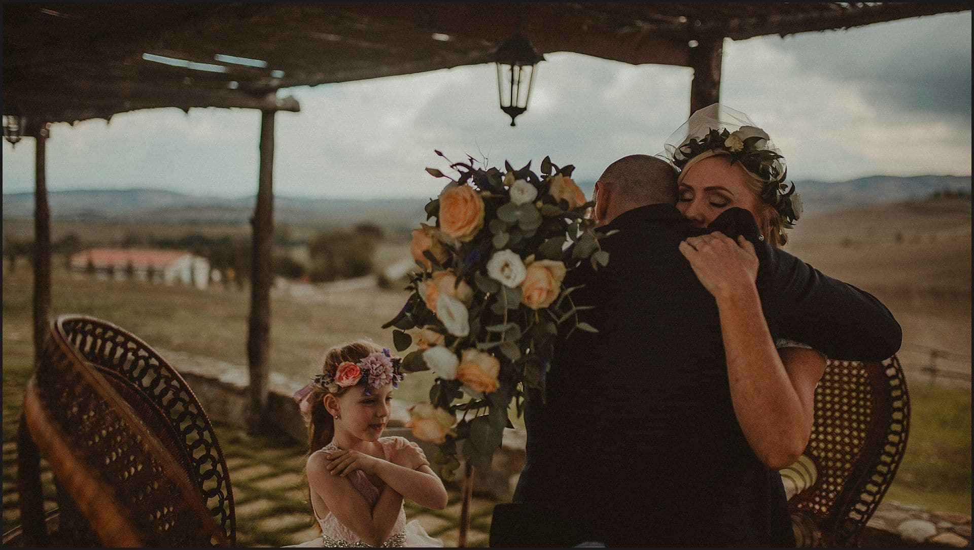 emotional moment, bride and groom, hug, flowers, locanda in tuscany, destination wedding, siena, italy