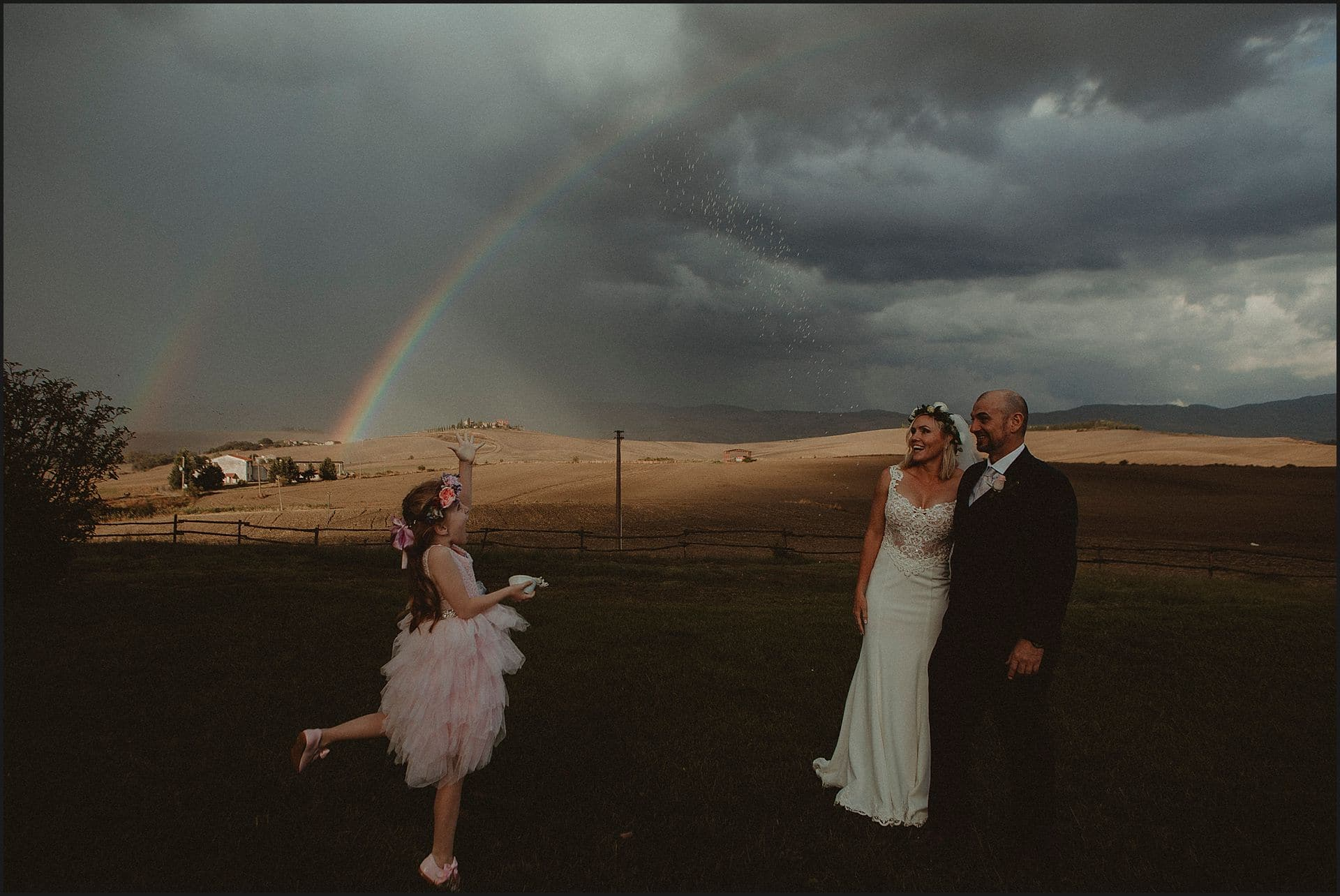 rainbow, rice tossing, maid of honor, bride, groom, happy moment, destination wedding photographer, locanda in tuscany, italy