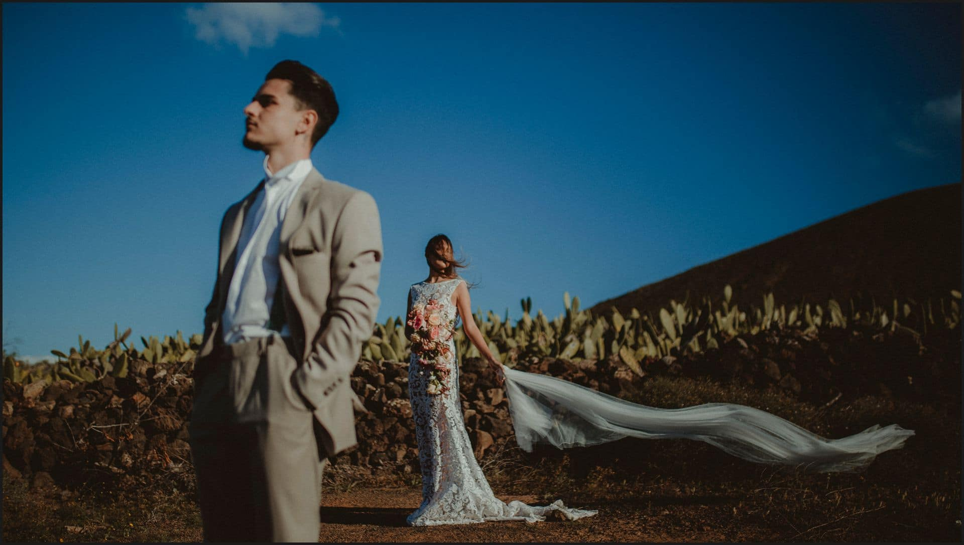 lanzarote, wedding, elopement, bride, groom, wind, veil, blue sky