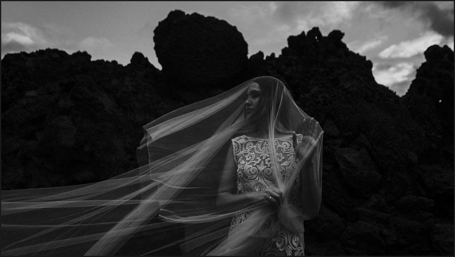 lanzarote, wedding, elopement, bride, groom, adventure wedding, black and white, veil, wind