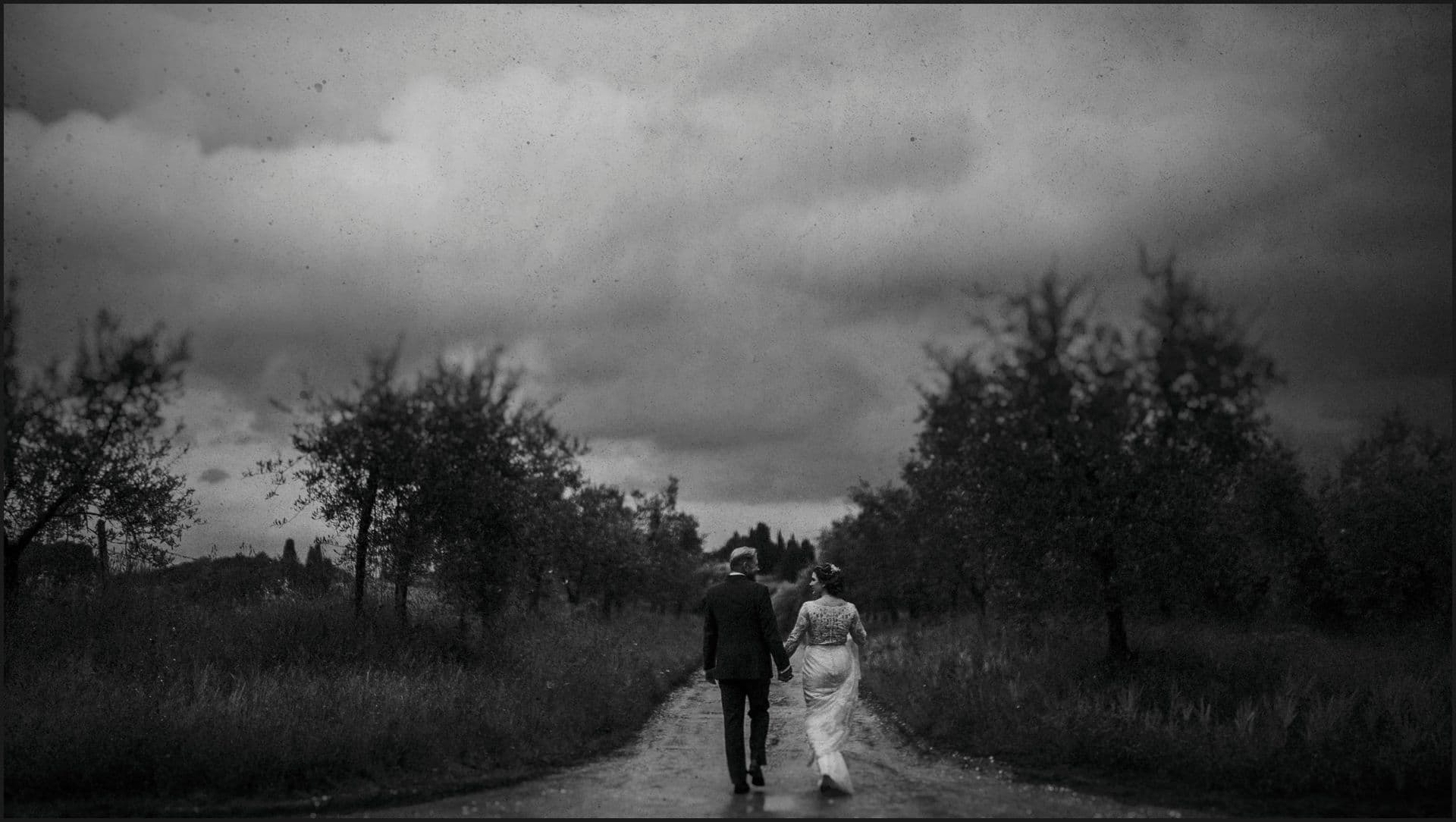 tuscany, destination wedding, chianti, bride, groom, walking, black and white