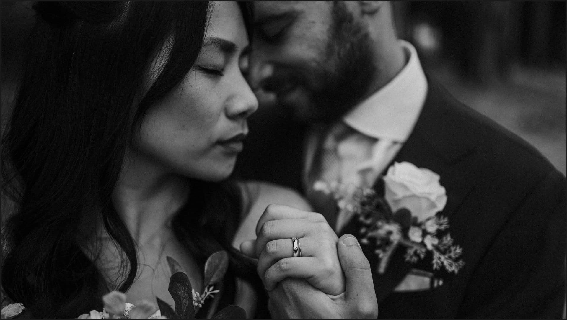 destination wedding, castello del trebbio, tuscany, bride, groom, black and white, hands, rings, intimate portrait