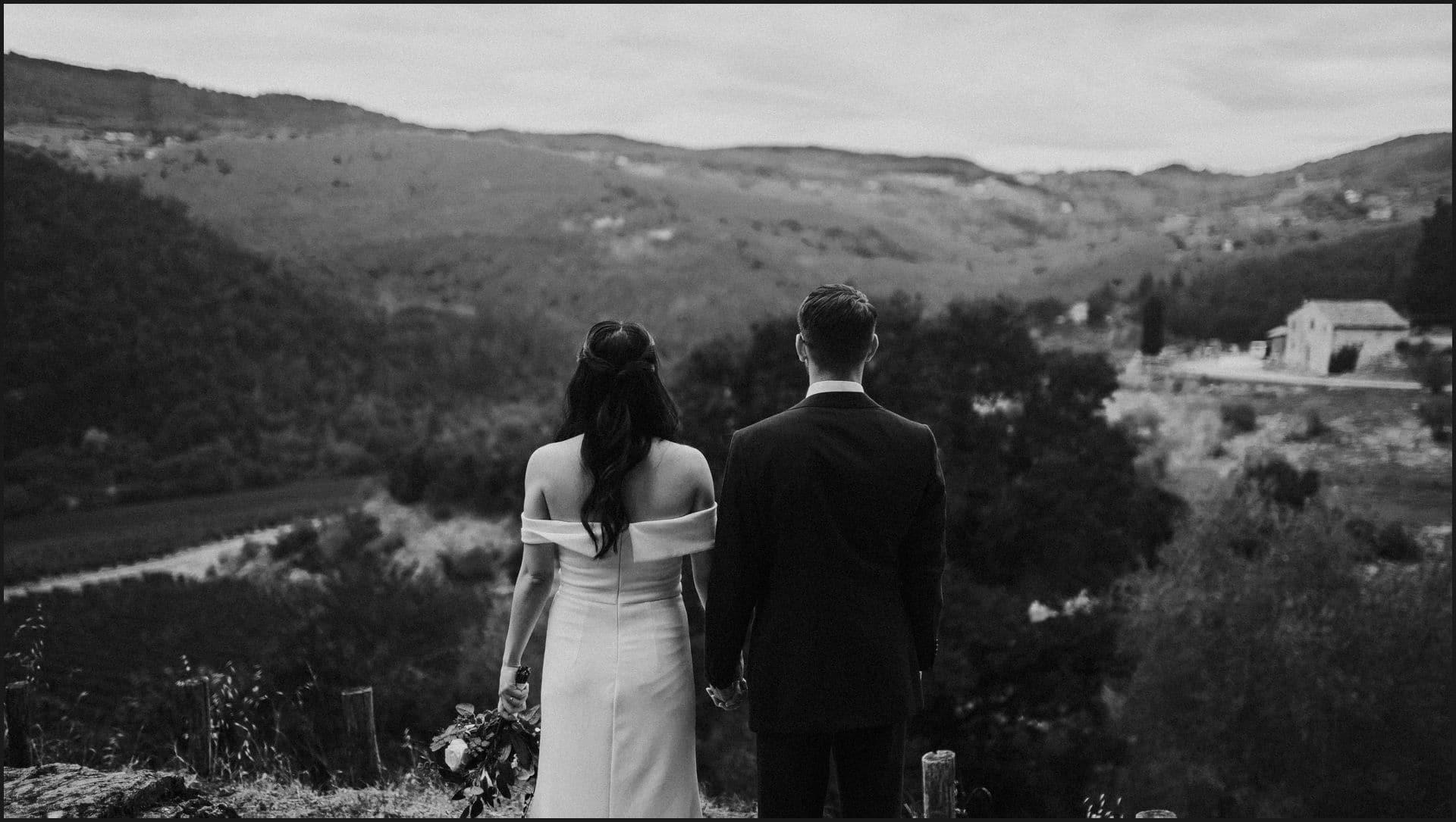 destination wedding, castello del trebbio, tuscany, bride, groom, black and white, view