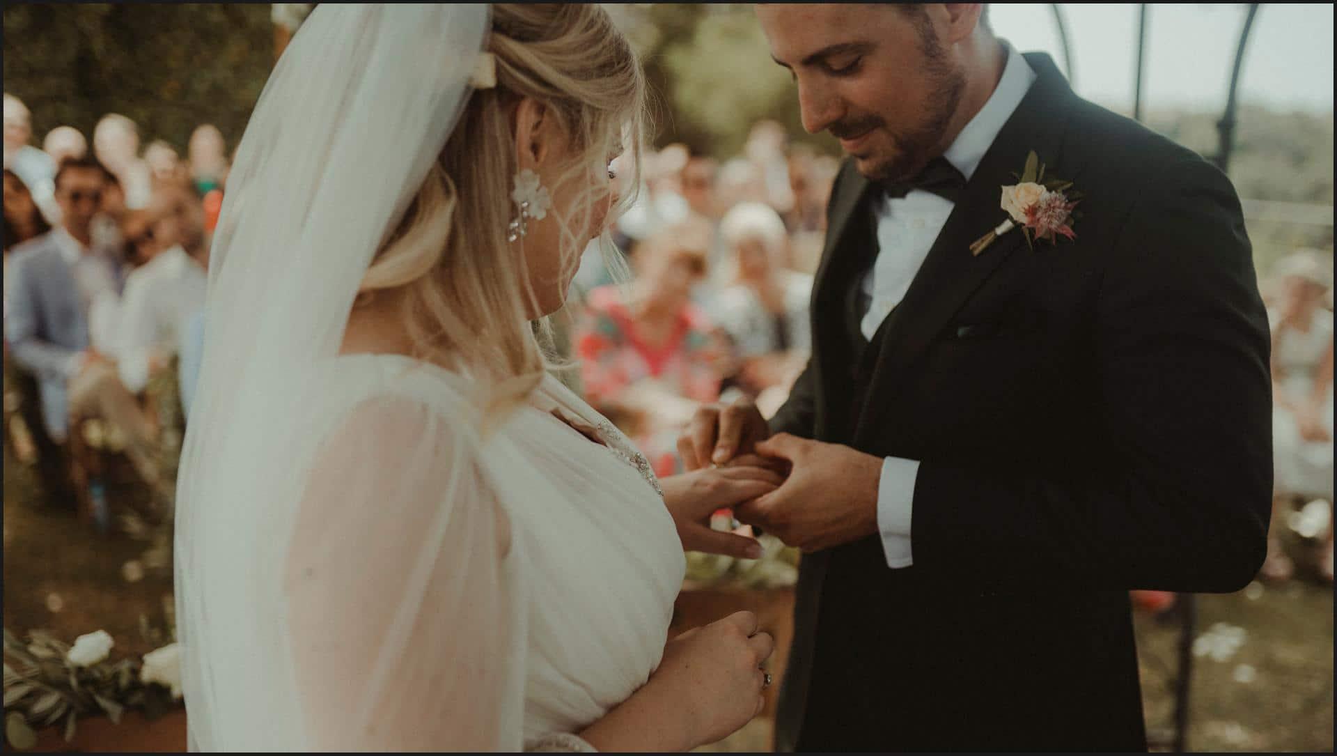 borgo di tragliata, wedding, rome, wedding in rome, bride, groom, wedding band, exchanging of the rings